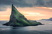 Tindholmur Island in sunset on Vagar, Faroe Islands