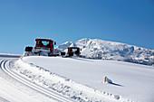 Slope preparation in Reit im Winkl in winter, Chiemgau, Bavaria, Germany