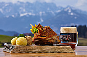 Bavarian specialty with a view of the Kaiser Mountains, Reit im Winkl, Chiemgau, Bavaria, Germany