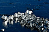 Unusual ice formation in the morning light on a lake, Grimsholmen, Halland, Sweden