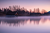 View of the wooden huts in Kochelsee, Schlehdorf at sunrise, Bavaria, Germany, Europe