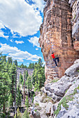 "Man rock climbing at ""The Pit"" in Sandy's Canyon, Flagstaff, Arizona, USA"