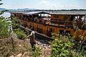 Woman descends to river cruise ship Mekong Sun on Mekong River, Houayxay (Huay Xai), Bokeo Province, Laos, Asia