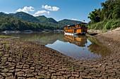 River cruise ship Mekong Sun lies on the banks of the Mekong River, Pak Ou, Luang Prabang Province, Laos, Asia