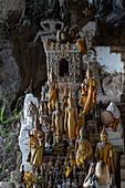 Miniature Buddha sculptures adorn the lower cave in the Pak Ou Caves, Pak Ou, Luang Prabang Province, Laos, Asia
