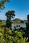 View from the Pak Ou Caves over lush vegetation to the Mekong River, Pak Ou, Luang Prabang Province, Laos, Asia
