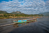 Longtail excursion boat on Mekong River, near Luang Prabang, Luang Prabang Province, Laos, Asia