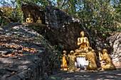 Golden Buddha figures on a path to Mount Phousi, Luang Prabang, Luang Prabang Province, Laos, Asia