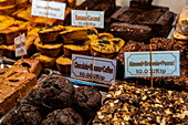 Delicious cakes and other baked goods are for sale at the night market, Luang Prabang, Luang Prabang Province, Laos, Asia