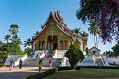 Tourists in front of the Haw Pha Bang (Royal Temple) next to the Royal Palace, Luang Prabang, Luang Prabang Province, Laos, Asia