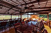 Restaurant area on board the river cruise ship Mekong Sun  on the Mekong river, Luang Prabang, Luang Prabang Province, Laos, Asia