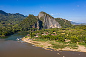 Aerial view of Pak Ou village along the Mekong River with mountains behind, Chomphet District, Luang Prabang Province, Laos, Asia