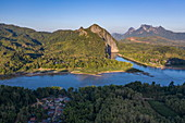 Aerial view of the village of Ban Muang Keo on the Mekong River with mountains behind, Ban Muang Keo, Chomphet District, Luang Prabang Province, Laos, Asia