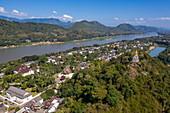 Aerial view of the pagoda on Mount Phousi with the Mekong River behind it, Luang Prabang, Luang Prabang Province, Laos, Asia