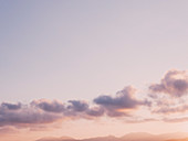 Pale purple and clouds in tranquil sunset sky