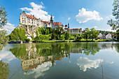 Sigmaringen Castle reflecting in Danube river, Upper Danube Valley, Swabian Jura, Baden-Wurttemberg, Germany, Europe