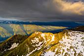 Sunrise over Orobie Alps from Sasso Bianco, aerial view, Valmalenco, Sondrio province, Valtellina, Lombardy, Italy, Europe
