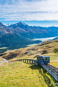 Chantarella-Corviglia funicular traveling uphill with St Moritz lake in background, Engadine, canton of Graubunden, Switzerland, Europe