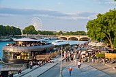 France, Paris, area listed as World Heritage by UNESCO, the New Pedestrian Berges at the Port of the Champs Elysees, the barge bar restaurant the Flow