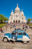 France, Paris, Montmartre, the Sacred Heart and a 2CV