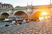 France, Paris, area listed as World Heritage by UNESCO, Ile de la Cite, the Quai des Orfevres at sunset, the Pont Neuf