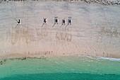 France, Finistere, Glenan archipelago, Penfret island, catamarans on the sand (aerial view)