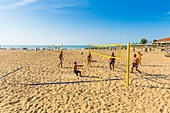 France, Pyrenees Atlantiques, Bask country, Anglet people playing beach volleyball on Golden Sands Beach