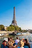 France, Paris, the banks of the Seine classified UNESCO, tourist tour by riverboat in front of the Eiffel Tower