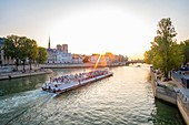 France, Paris, the UNESCO listed banks of the Seine River, a sunset boat ride in front of Saint Louis island and Notre Dame