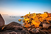 France, Cotes d'Armor, Pink Granite Coast, Perros-Guirec, on the Customs footpath or GR 34 hiking trail, Ploumanac'h or Mean Ruz lighthouse at sunset