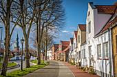 Street at the harbor in Tönning with St. Laurentius Church, North Friesland, Schleswig-Holstein