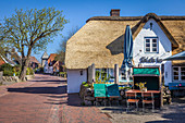 Cafe in an old thatched roof house in St. Peter Dorf, St. Peter-Ording, North Friesland, Schleswig-Holstein