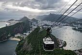 View over city from Sugar Loaf Mountain (Pao de Acucar) with Sky Gondola cable car, Rio de Janeiro, Rio de Janeiro, Brazil, South America