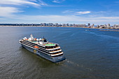 Aerial view of expedition cruise ship World Explorer (Nicko Cruises) with city skyline behind, Punta del Este, Maldonado Department, Uruguay, South America