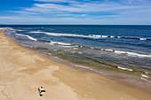 Aerial view of surfers on the beach with coastline, Punta del Este, Maldonado Department, Uruguay, South America