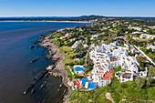 Aerial view of Casapueblo Hotel and Gallery by artist Carlos Paez Vilaro in Punta Ballena, Punta del Este, Maldonado Department, Uruguay, South America
