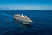 Aerial view of the expedition cruise ship World Explorer (nicko cruises) sailing through deep blue water in the South Atlantic, near Brazil, South America