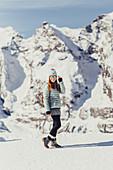 Woman has fun on the glacier, Diavolezza, Upper Engadin, Grisons, Switzerland, Europe