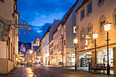 Reichenstrasse in the old town of Füssen with a view of Hohes Schloss, Allgäu, Bavaria, Germany