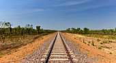 Endless, dead straight railroad track in the outback, near Pine Creek, Northern Territory, Australia
