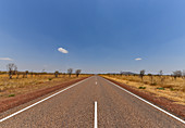 Lonely highway to the horizon in the outback, near Kununurra, Western Australia, Australia