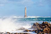 The lighthouse at Cap de la Hague during a winter storm.