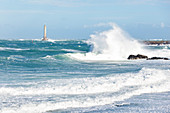 Rough seas at Goury lighthouse during a winter storm. Cotentin Peninsula, Normandy, France