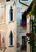 Detail of the facade of an ancient building in the medieval town of Spilimbergo in the province of Pordenone. Friuli region, Italy.