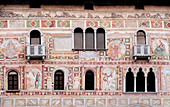 The façade of the castle of spilimbergo with a colorful fresco and three-light windows in the province of Pordenone. Friuli Region. Italy