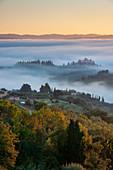 Foggy morning in autumn below San Gimignano, Tuscany, Italy, Europe