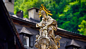 Well saint on the market square of Hallstatt on Lake Hallstatt, Salzkammergut, Austria, Europe