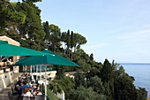From the terraces of Cafe Kanoni in the eponymous district of Kerkira you can see the Vlacherna monastery and the Mouse Island, Analipsi peninsula, Corfu island, Ionian Islands, Greece