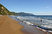 Glyfada Beach (also Glifada Beach) is located a little north of the village of Pelekas at the foot of the steep west coast, Pelekas, Corfu Island, Ionian Islands, Greece