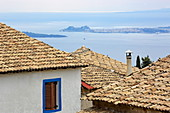 View over roofs of the village of Spartilas to the port and town of Kerkira, Corfu Island, Ionian Islands, Greece